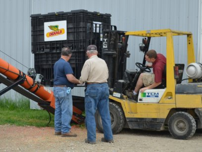 Josh and Fred Yoder unloading DEKALB seed corn.